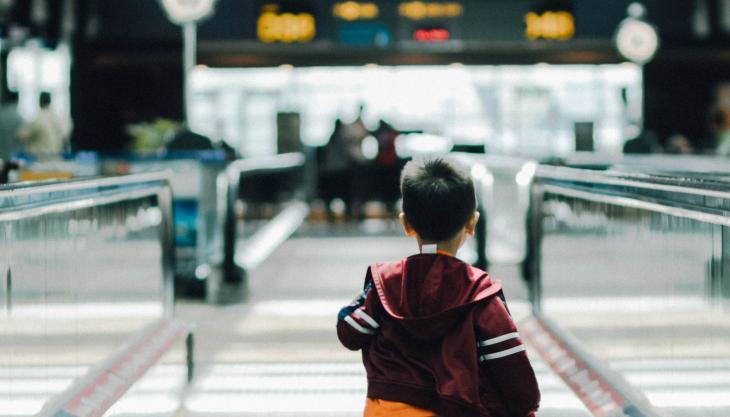 Child running through an airport