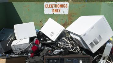 dumpster with computers