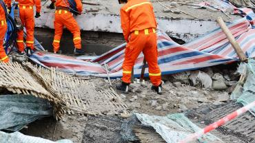 Rescue team searching through rubble