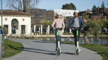Image of two riders on e-scooters