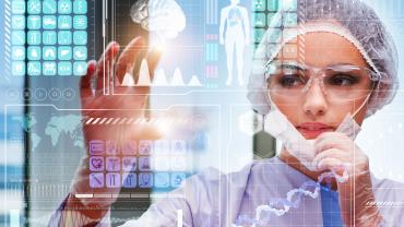 Woman doctor looking at futuristic screen
