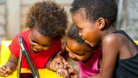 African girls using a smart tablet