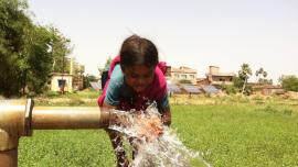 girl drinking from water pipe