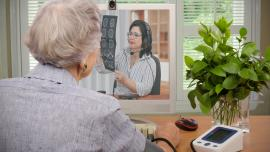 Older person receiving medical advice online