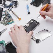 tech repairing smartphone