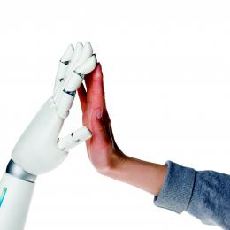 Robot and human hand touching