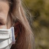Young girl wearing protective mask