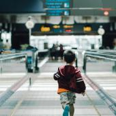Child running through an airport