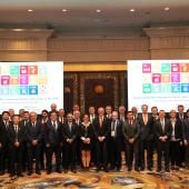 SMB Members wearing the IEC SDGs badge